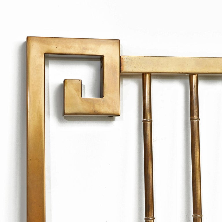 Breath-taking Hollywood Regency brass Mastercraft headboard. The vertical spanners are fashioned in the style of bamboo stalks to add an Eastern flare. Hollywood Regency, Asian modern and Greek style meld together beautifully in this stunning and