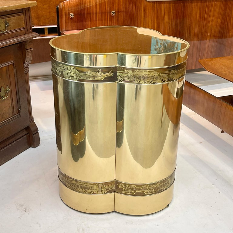 Mastercraft trifoliate form pedestal table base clad in mirror polished and clear lacquered brass sheet with art metal bands of acid etched brass by artist Bernhard Rohne.  27.5 inches high by 21 inches diameter.  Per the original Mastercraft