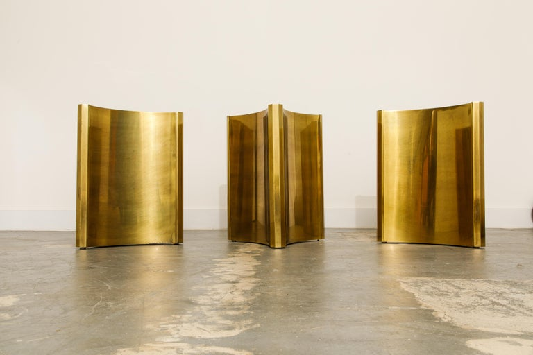One of the hottest items currently with interior designers are these gleaming brass 'Trilobi' Mastercraft dining table bases, which also work excellent for a desk, feature a hefty triangular design with sculpted ends. The gorgeous brass displays
