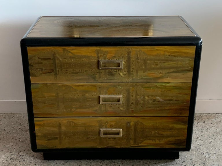 A great 1960s three-drawer chest of drawers and matching mirror by Bernhard Rohne for Mastercraft. Acid etched brass and lacquered wood, with rounded corners on the chest. The mirror is not attached.