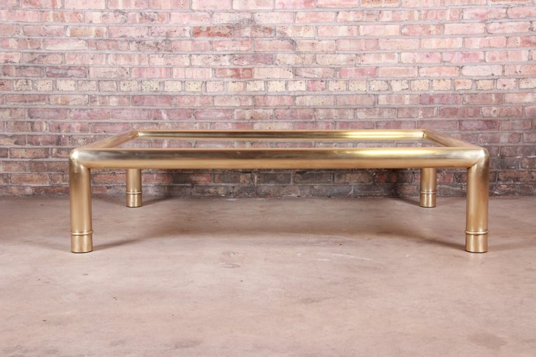 An exceptional monumental Hollywood Regency chinoiserie coffee or cocktail table.  By Mastercraft  USA, circa 1970s  Solid brass and beveled glass top.  Measures: 60