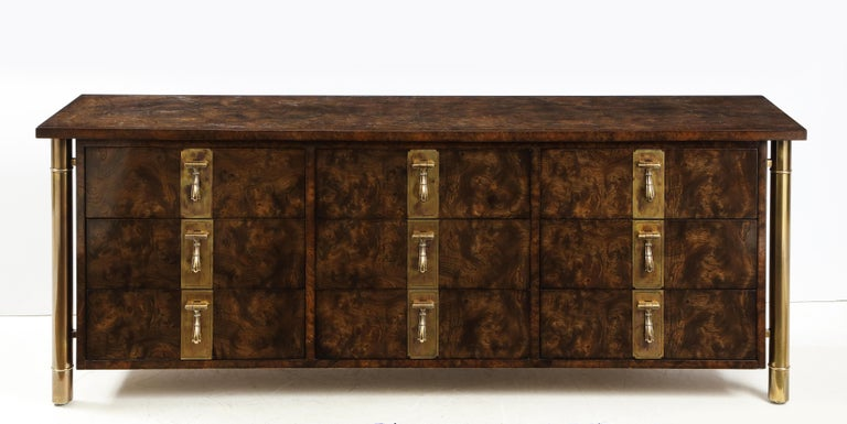 Stunning 1970s nine-drawer burl elmwood and brass hardware dresser designed by William Doezema for Mastercraft, in vintage original condition with minor wear and beautiful patina.