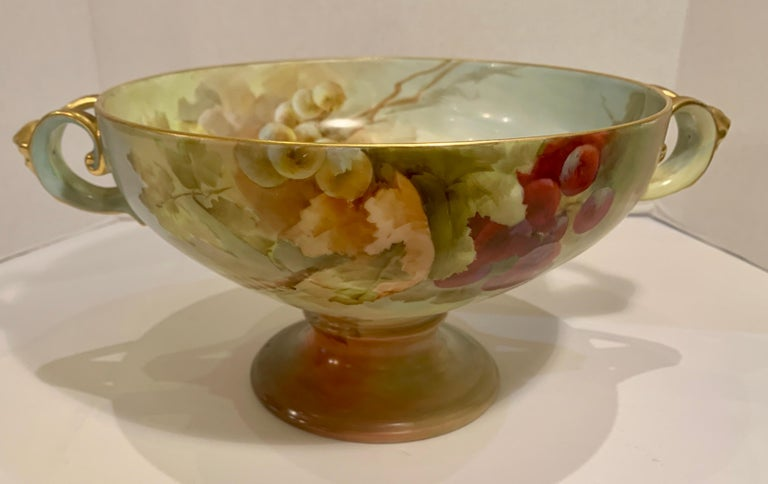 "Exquisite large antique fine porcelain Art Nouveau Philipp Rosenthal Bavarian ""Empire"" pedestal footed centerpiece bowl is from the early 1900s. Bowl is lavishly hand painted inside and outside with magnificent, colorful and very realistic clusters"