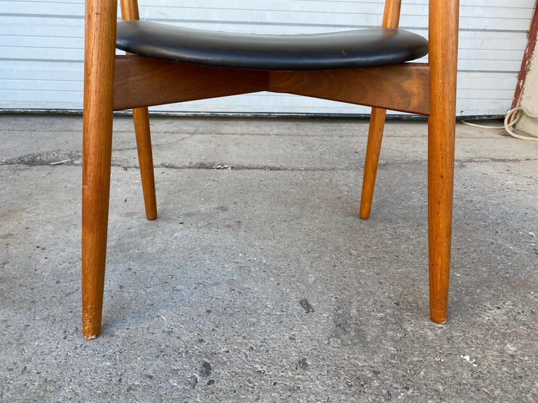 Solid teak frames, seat leather upholstered, model 59. Designed in 1960 by Harry Ostergaard for Randers Møbelfabrik. Superior quality and construction, extremely comfortable, amazing design. Stamped under seats.