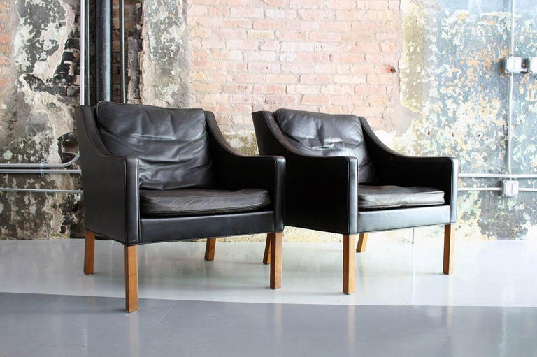 Beautiful pair in vintage original condition. Down filled leather cushions. Danish craftsmanship and modern lines.