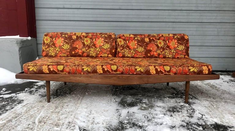 Matched pair of modernist daybeds designed by Adrian Pearsall. Classic Mid-Century Modern, beautiful walnut frames, superior quality and construction, original cross springs in excellent condition, retain they're original vintage orange and black
