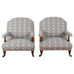 Matched Pair of 19th Century Howard & Sons Open Arm Armchairs
