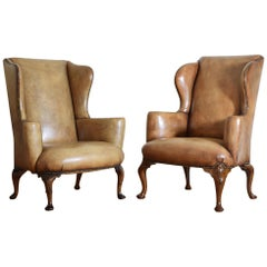 Matched Pair of George II Style Walnut Leather Upholstered Wing Chairs