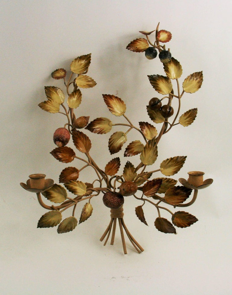 2-4026 a pair of circa 1940s Italian tole double arm candle sconces. Adorned with leaves and acorns.