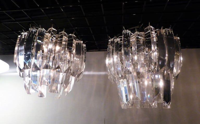 Sold individually, a matching pair of midcentury two-tier flush mount lights with Lucite crystals. Just slightly different in size, one is 1/2 inch longer from the ceiling. Both have the same amount of Lucite Crystals and have the same 12 inch