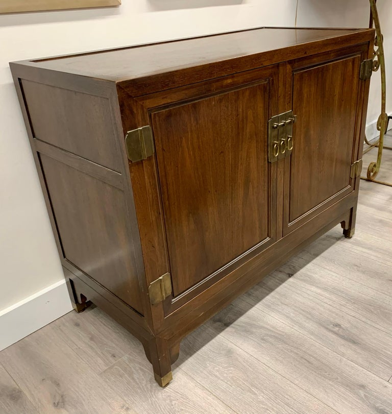 Matching pair of Baker Furniture walnut sideboards cabinets with great scale and better lines. Baker Furniture is one of the great furniture makers in the world. Multipurpose utilization - the opportunities are many. Now, more than ever, home is