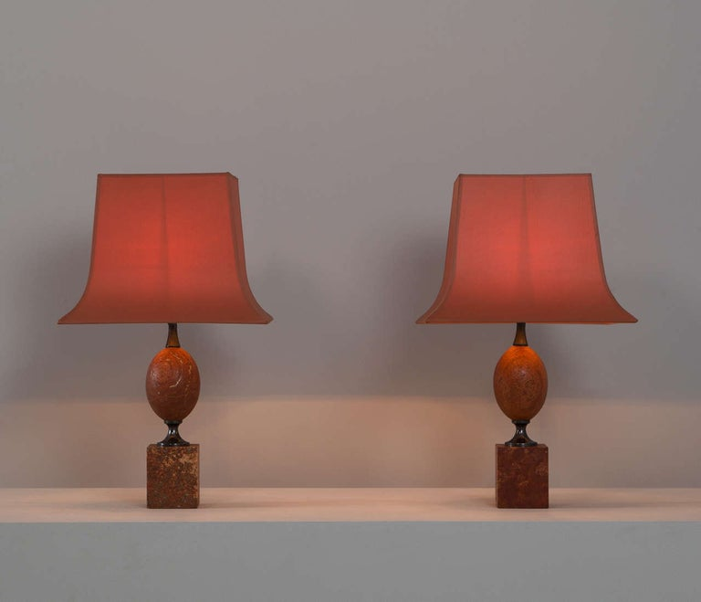 Set of table lights, in travertine, for Maison Barbier, France, 1960s.   Matching pair of elegant lights by Maison Barbier in rare red travertine. Both the base, and the shade show interest shaped and well designed lines.