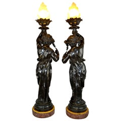 Matching Pair of Figural Patinated Bronze Flame Torcheres after Clodion