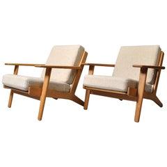 Matching Pair of Hans J Wegner GE290 Oak Lounge Chairs