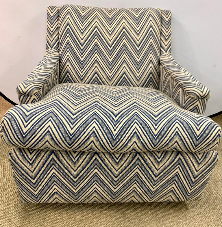 Newly upholstered in a tan and blue chevron fabric is this pair of mid century modern arm chairs. All dimensions are below. One of the most comfortable pair of chairs we've ever sat in. Fully refurbished. Now, more than ever, home is where the heart