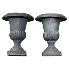 Matching Set Cast Iron Urn Planters in Gray, a Pair