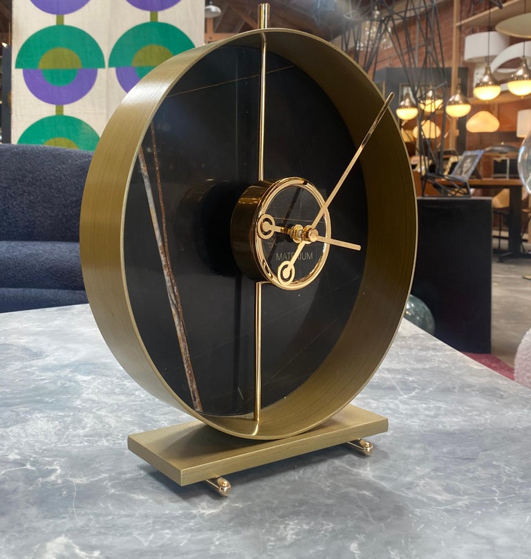 The Materico collection is a family of watches dedicated to the world of interiors. The collection is characterized by a table clock and a wall clock with a minimal design but at the same time very scenic thanks to the use of materials such as