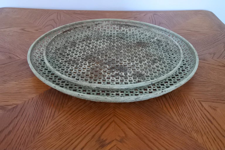 Set of two perforated metal serving trays or platters by French designer Mathieu Mategot.