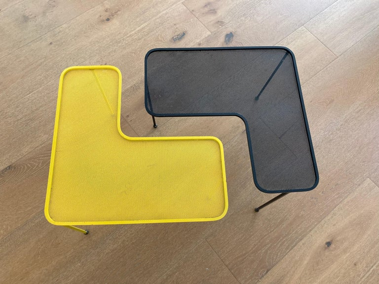 Pair of Domino coffee tables by Mathieu Matégot. Black and yellow, lacquered perforated metal and brass.