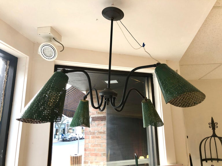 French modernist ceiling lamp makes great design out of common industrial materials. Four fully pivoting sheet metal shades provide great direct and ambient light.