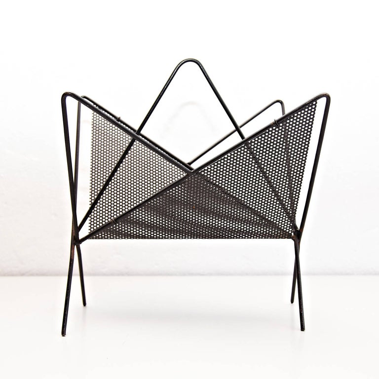Magazine holder designed by Mathieu Matégot.