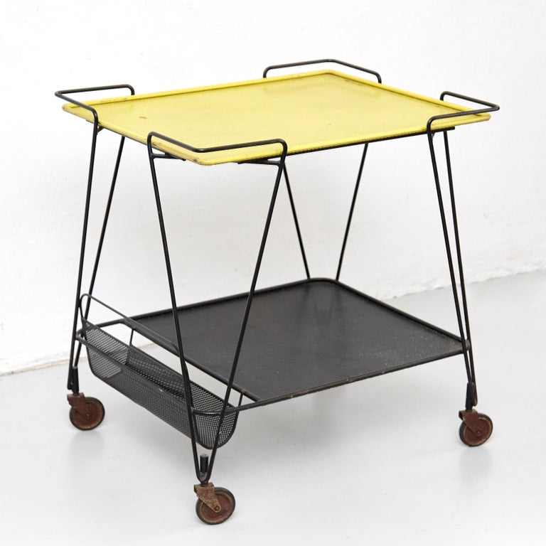 Trolley designed by Mathieu Matégot. Manufactured by Ateliers Matégot (France), circa 1950. Folded, perforated metal lacquered in black.  In good original condition, with minor wear consistent with age and use, preserving a beautiful patina,