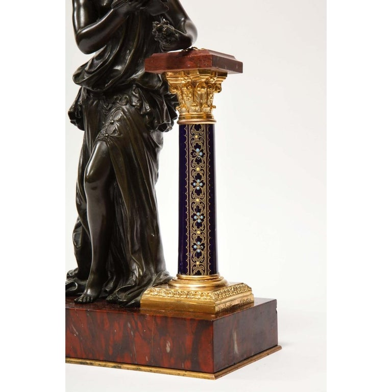An Exquisite French gilt and patinated bronze sculpture of Venus, resting on a Sèvres style cobalt blue enameled porcelain pedestal, on rouge marble base, by Mathurin Moreau, circa 1880.    This sculpture is not an ordinary one. It's very rare,