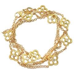 Matinee-Length Diamond Quatrefoil Station Chain in Yellow Gold