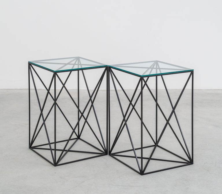 Black steel and glass table fashioned after Fehren's signature X-aesthetic.