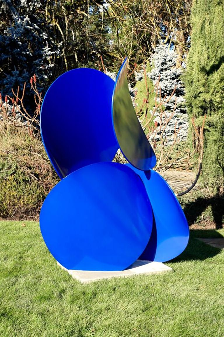Large, freestanding sculpture by Matt Devine. Bold and biomorphic, a x b #14 is made from aluminum coated with Powdercoat paint and set on a concrete base. Comprised of repeatedly stacked circles, this sculpture can also be placed indoors and