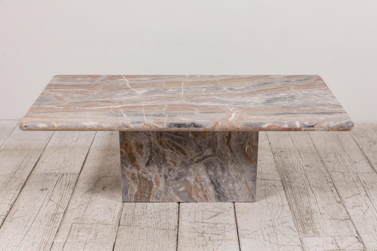 Honed marble rectangular coffee table offers beautiful markings and softened edges.