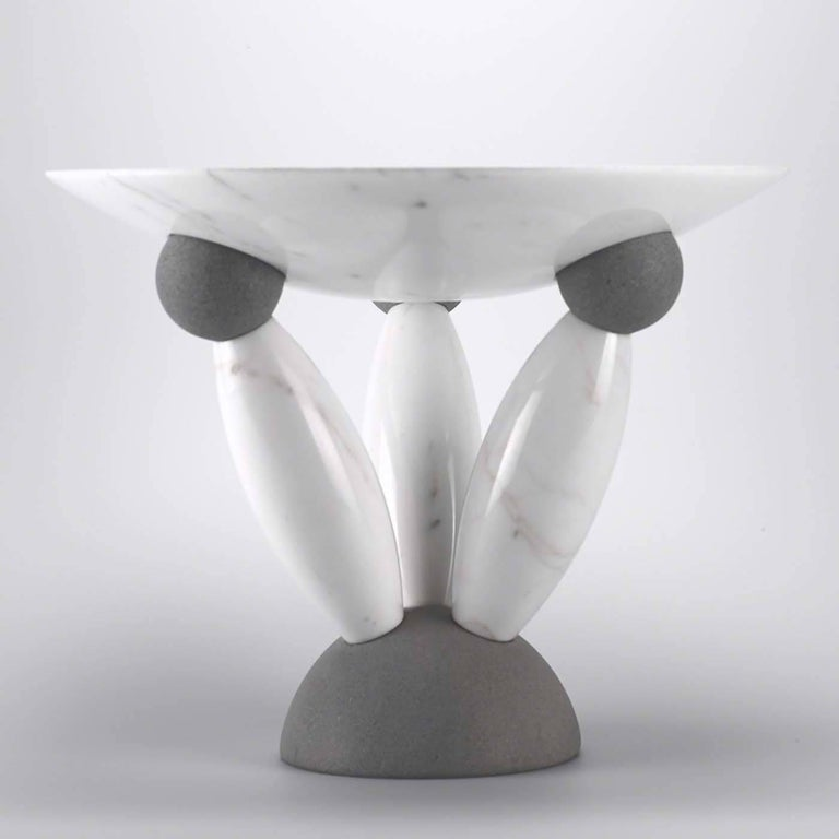 This unique bowl was designed by Matteo Thun and makes a statement whether used for holding fruit or as an outstanding display piece. Made of the highest quality Italian natural stone, it features a shallow bowl in white marble atop a sculptural,