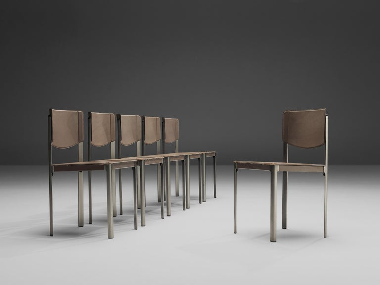 Matteo Grassi, set of six dining chairs, leather and steel, Italy, 1980s.  These sophisticated grey leather chairs by Matteo Grassi, feature an angular design. The seat and base are upholstered in leather, leaving the metal frame bare. The leather