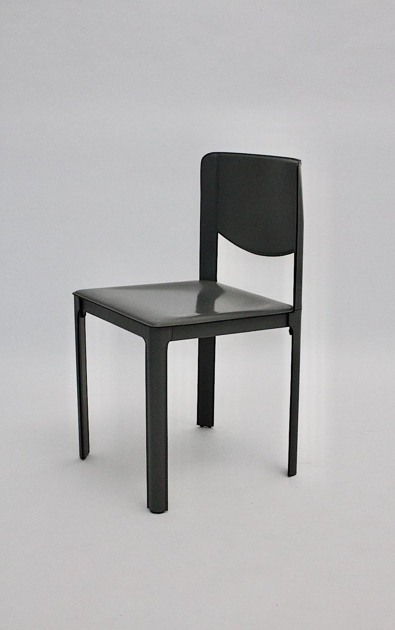 A Matteo Grassi vintage grey leather chair or side chair, which was designed and manufactured 1980s in Italy. The stable and comfortable high-end chair is completely covered with grey stitched saddle leather and is stamped with the manufacturer