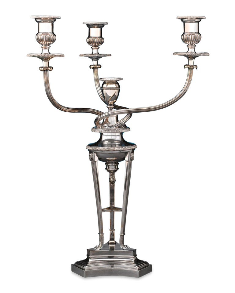 This remarkable Sheffield silver plate candelabrum by celebrated English silversmith Matthew Boulton displays all of the timeless elegance and style of the period. Masterfully crafted with sterling silver bobèches, this candelabrum exemplifies the