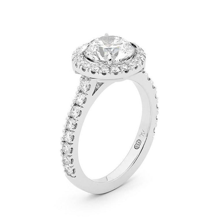 Contemporary 18 Carat White Gold Diamond Halo Engagement Ring GIA Certified For Sale