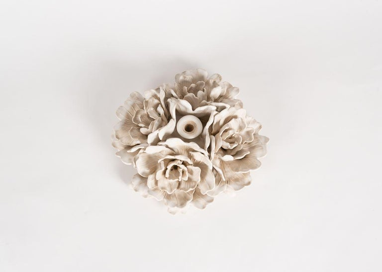 Glazed porcelain floral centerpiece with candle bobeche in the center, by Matthew Solomon. Signed and dated: Solomon '15.   Using fine porcelain and glazes he crafted himself, Matthew Solomon translated the unruly beauty of nature into works both