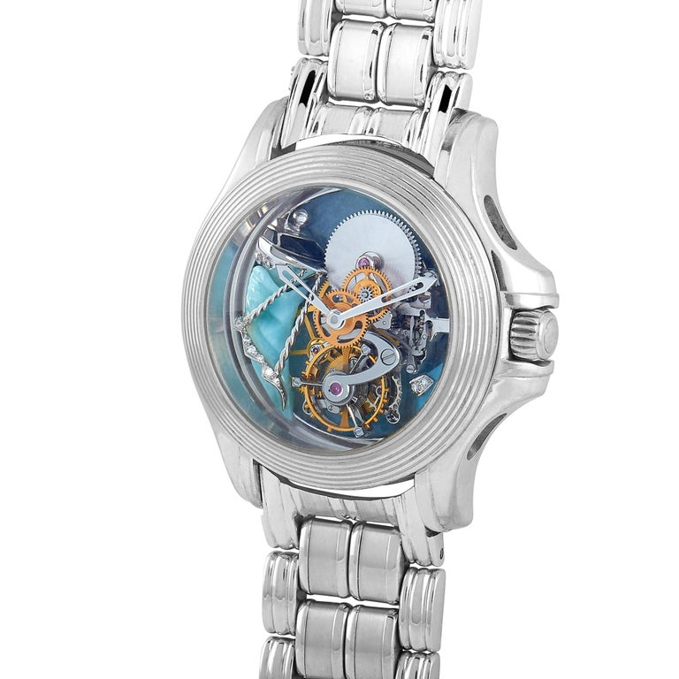 This Mauboussin timepiece boasts a 35 mm 18K white gold case that is presented on a matching 18K white gold bracelet. The watch is equipped with a hand-wound mechanical movement and features central hours and minutes and tourbillon on the