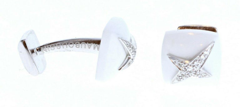 Mauboussin Diamond White Onyx 18K White Gold Etoile Divine Cufflinks 11.5g   For sale is a pair of Mauboussin 18k white gold and diamond cufflinks  Perfect worn day or night.  Get these stunning cufflinks now!   Metal: 18k white gold
