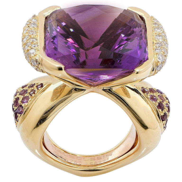 This wonderful design by Mauboussin, Paris features a modified cushion cut Amethyst which weighs approximately 20 carats and is flanked by triangular shaped panels pave set with 68 round brilliant cut diamonds with an estimated total weight of 1.4