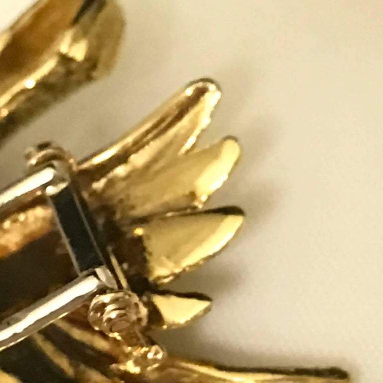 Discover this Mauboussin Pheasant pin in yellow gold with diamond eye. Yellow gold 18 carat with the punch quot : head of eagle. Signed by Mauboussin Paris on the wing.