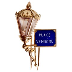 Mauboussin Place Vendôme Enamel and 18 Karat Gold Brooch