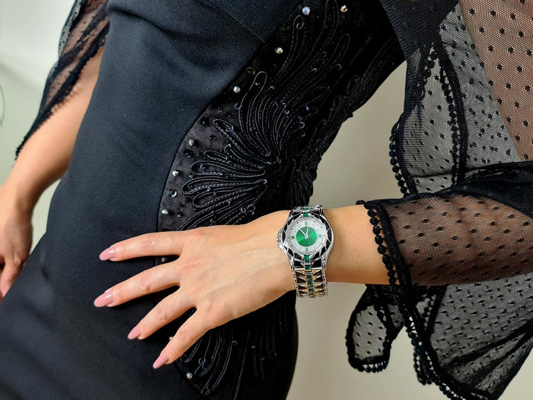 Exceptional quality Vintage watch by Mauboussin, in 18 carat white gold, automatic with emerald, diamond and onyx.  Bracelet Length 15.6 cm Dial Dimension 3.5 cm