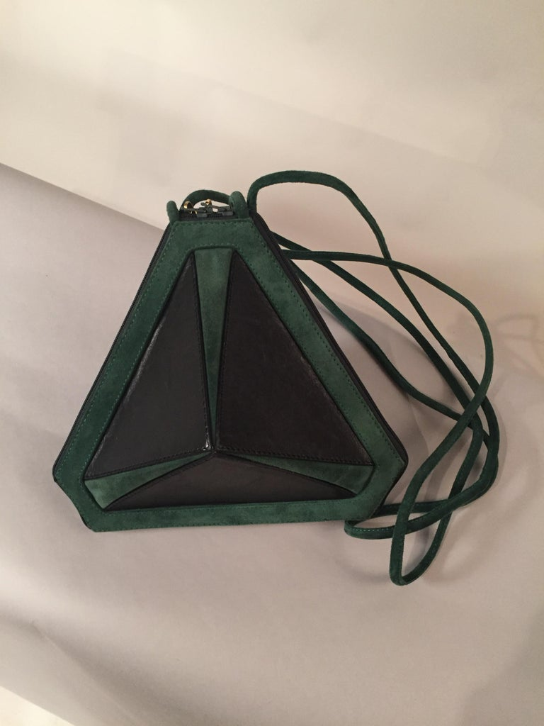 This bag Maud Frizon has the most unusual shape that I have ever seen, all angles and corners, with two zippers at the center with golden high heel zipper pulls. It is a real conversation piece!  The bag is made from black lambskin and forest green