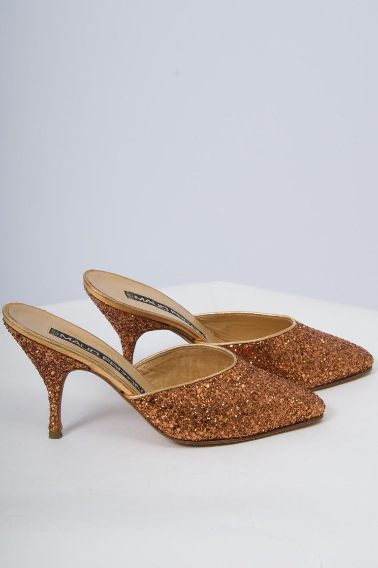 A great find, these Maud Frizon mules provide plenty of sparkle for the holidays and beyond. Edges bound in gold leather. Mid-size slender heel. Size 37. Never worn.