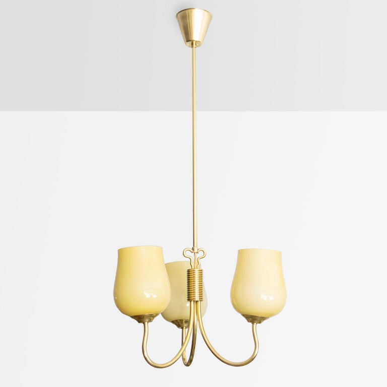 """A polished brass Scandinavian Modern 3-arm pendant designed by Mauri Almari for Idman, Finland, late 1940s. The lamp has been newly polished and newly rewired with 3 standard sockets for use in the USA. Shades are original.  Measures: Height 35"""","""