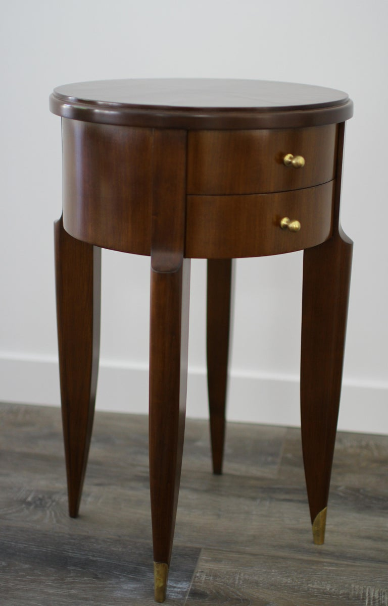 Maurice & Leon Jallot, pair of side tables, France, circa 1945. Can be used as sofa tables, sides tables, bedside tables. Beechwood and rosewood veneer, two drawers with brass knobs and sockets. Antique glass top. Refinished.