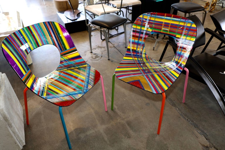A wonderfully decorated and stylized pair of chairs by the noted Brazilian American artist Mauro Oliveira. The chairs are new however each one is a unique work of art by Mauro and will never be repeated in the exact same way. The chairs are a