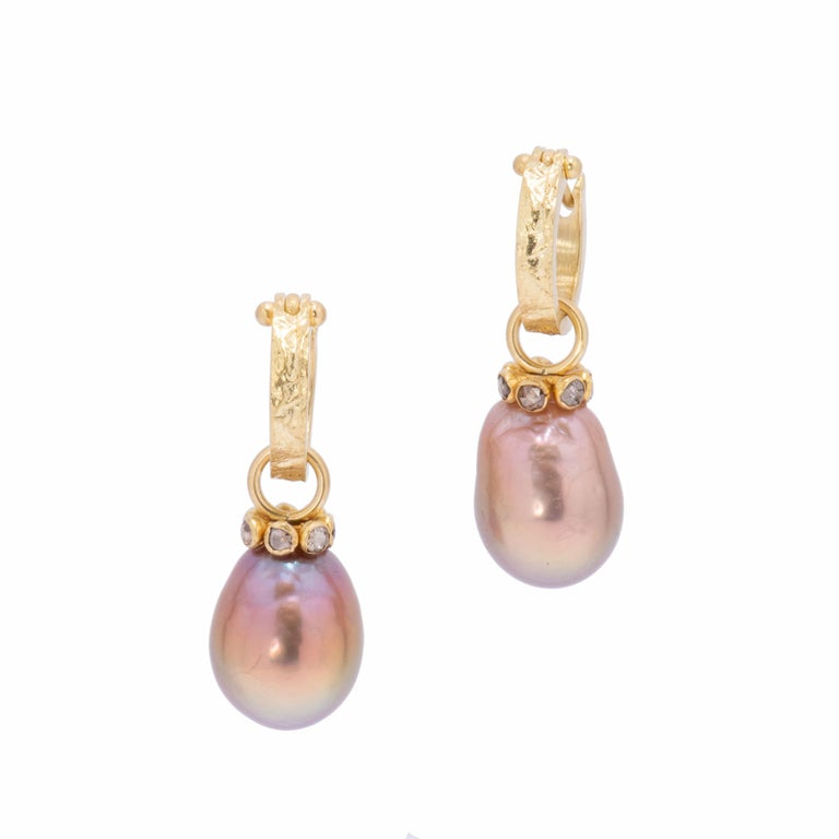 Mauve Pearl Drop Earrings are crafted with Yangtze River pearls and set with a circle of 7 cognac diamonds around each crown set in 22k gold. Naturally irregular pearls are cultured in mussel shells in the delta areas of the Yangtze River in China.