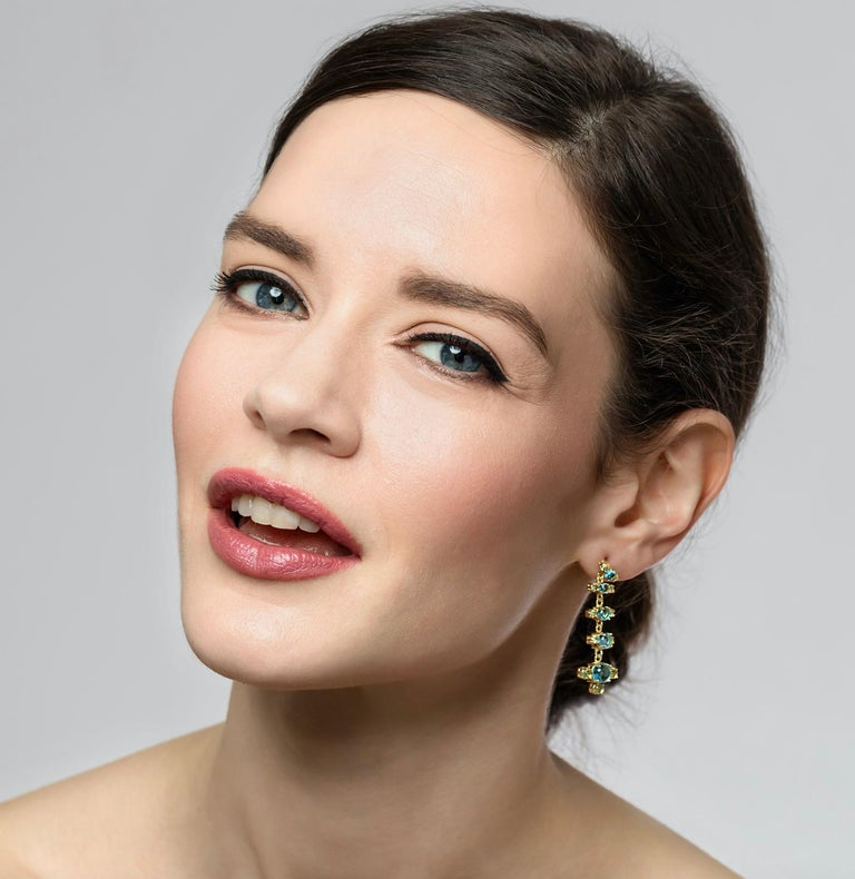 Our + Earrings in 18k yellow gold and brilliant coloured natural gemstone combinations are so feminine and chic. They come in three beautiful coloured combinations: Swiss Blue Topaz and green Peridot, green Peridot and Pink Tourmaline and Purple